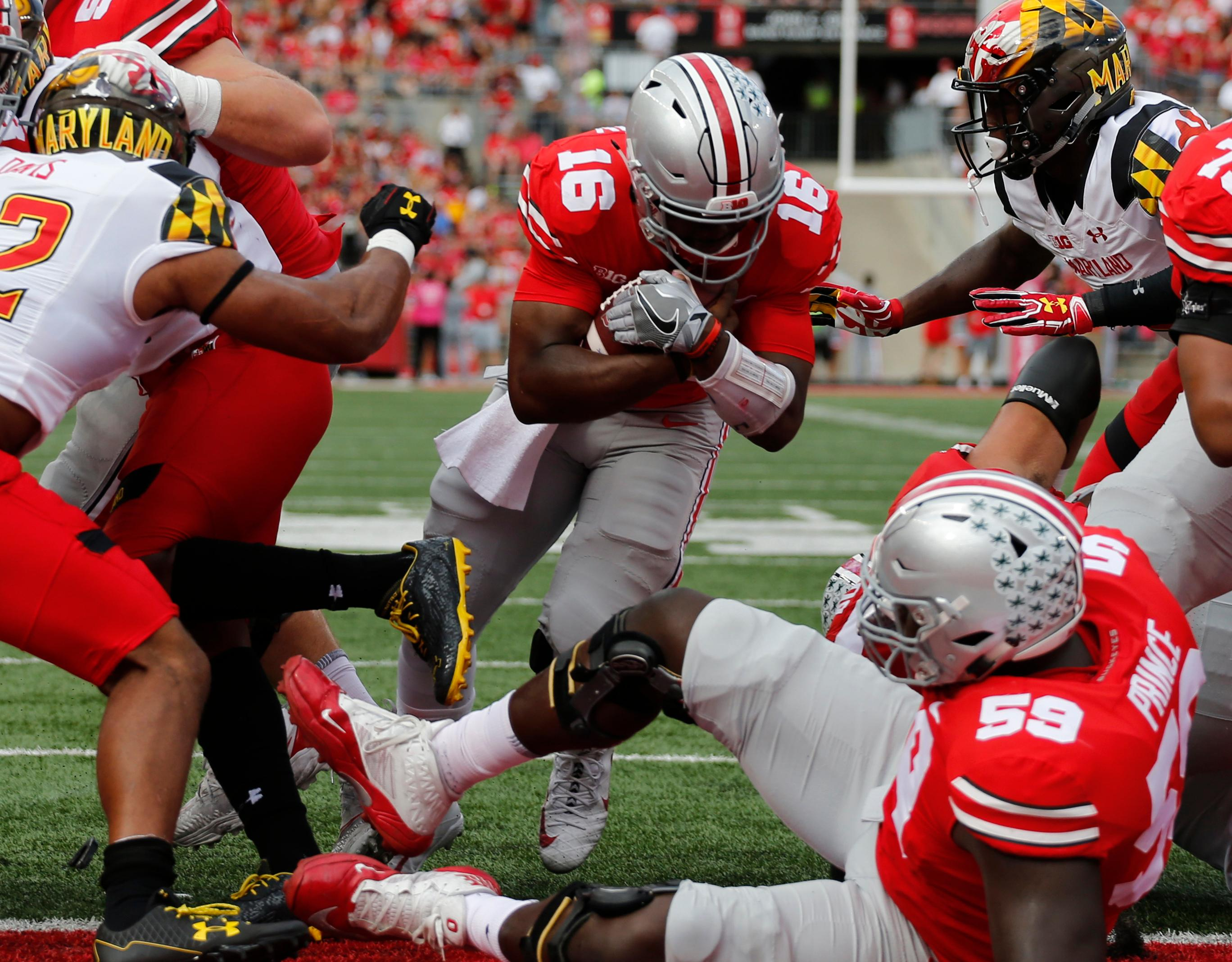 Ohio State quarterback J.T. Barrett, center, scores a touchdown against Maryland during the first half of an NCAA college football game Saturday, Oct. 7, 2017, in Columbus, Ohio. (AP Photo/Jay LaPrete)