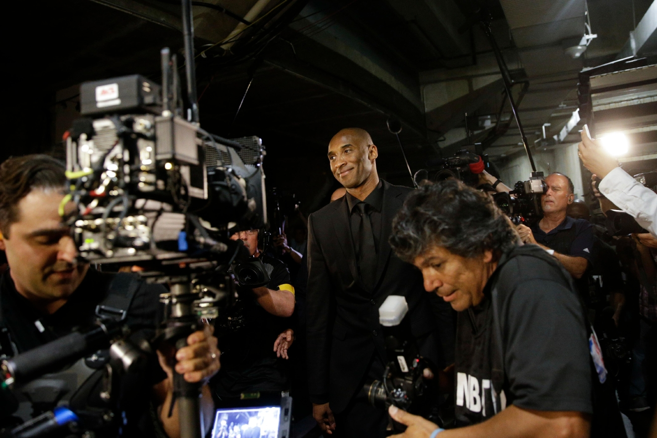 Los Angeles Lakers' Kobe Bryant smiles as he arrives for the last NBA basketball game of his career, against Utah Jazz, Wednesday, April 13, 2016, in Los Angeles. (AP Photo/Jae C. Hong)