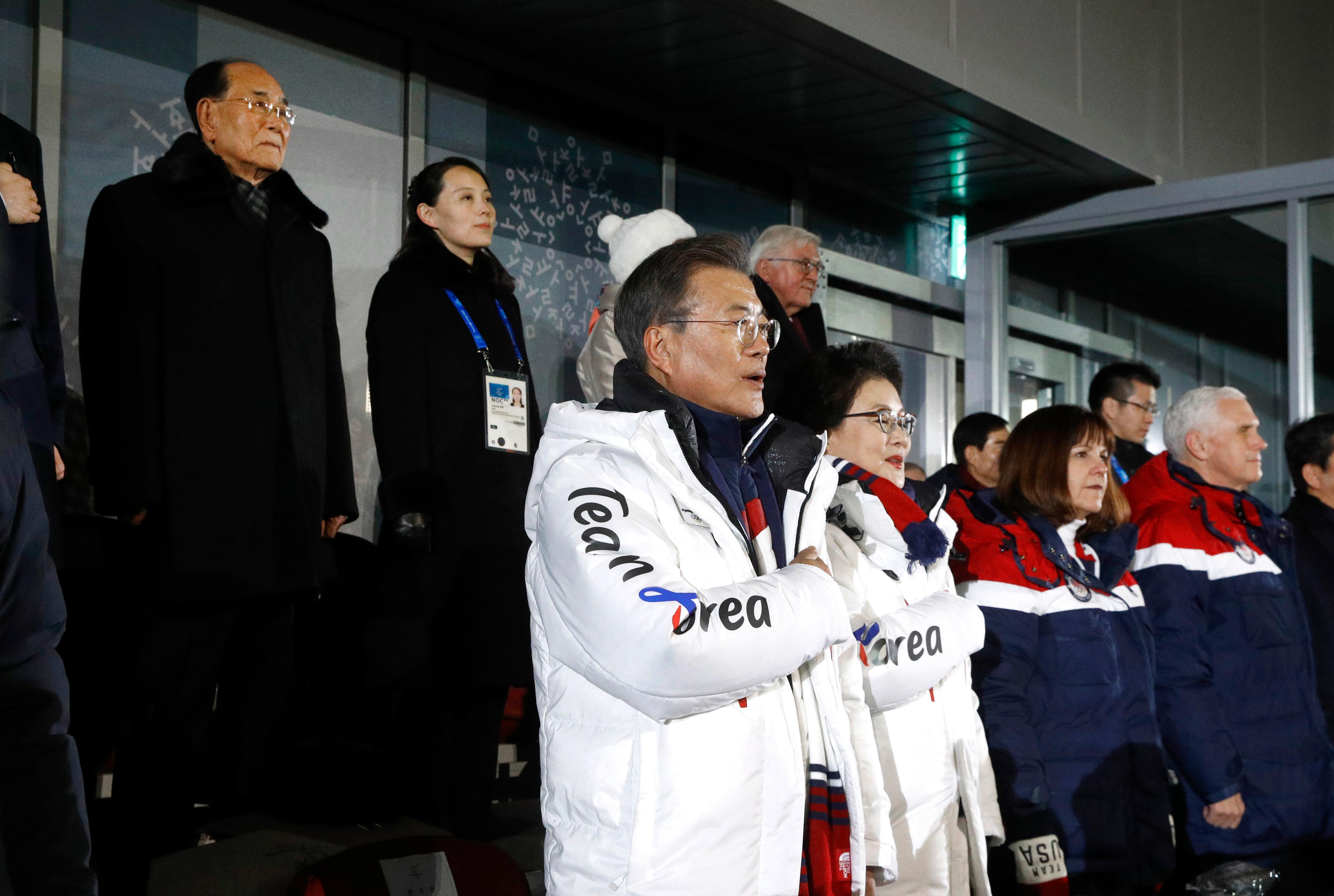 South Korean President Moon Jae-in, center, stands alongside first lady Kim Jung-sook, U.S. second lady Karen Pence and U.S. Vice President Mike Pence as the South Korean national anthem is played at the opening ceremony of the 2018 Winter Olympics in Pyeongchang, South Korea, Friday, Feb. 9, 2018. Standing at top left is Kim Yong Nam, president of the Presidium of North Korean Parliament, and Kim Yo Jong, sister of North Korean leader Kim Jong Un. (AP Photo/Patrick Semansky, Pool)