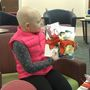 Girl with alopecia helping others feel beautiful