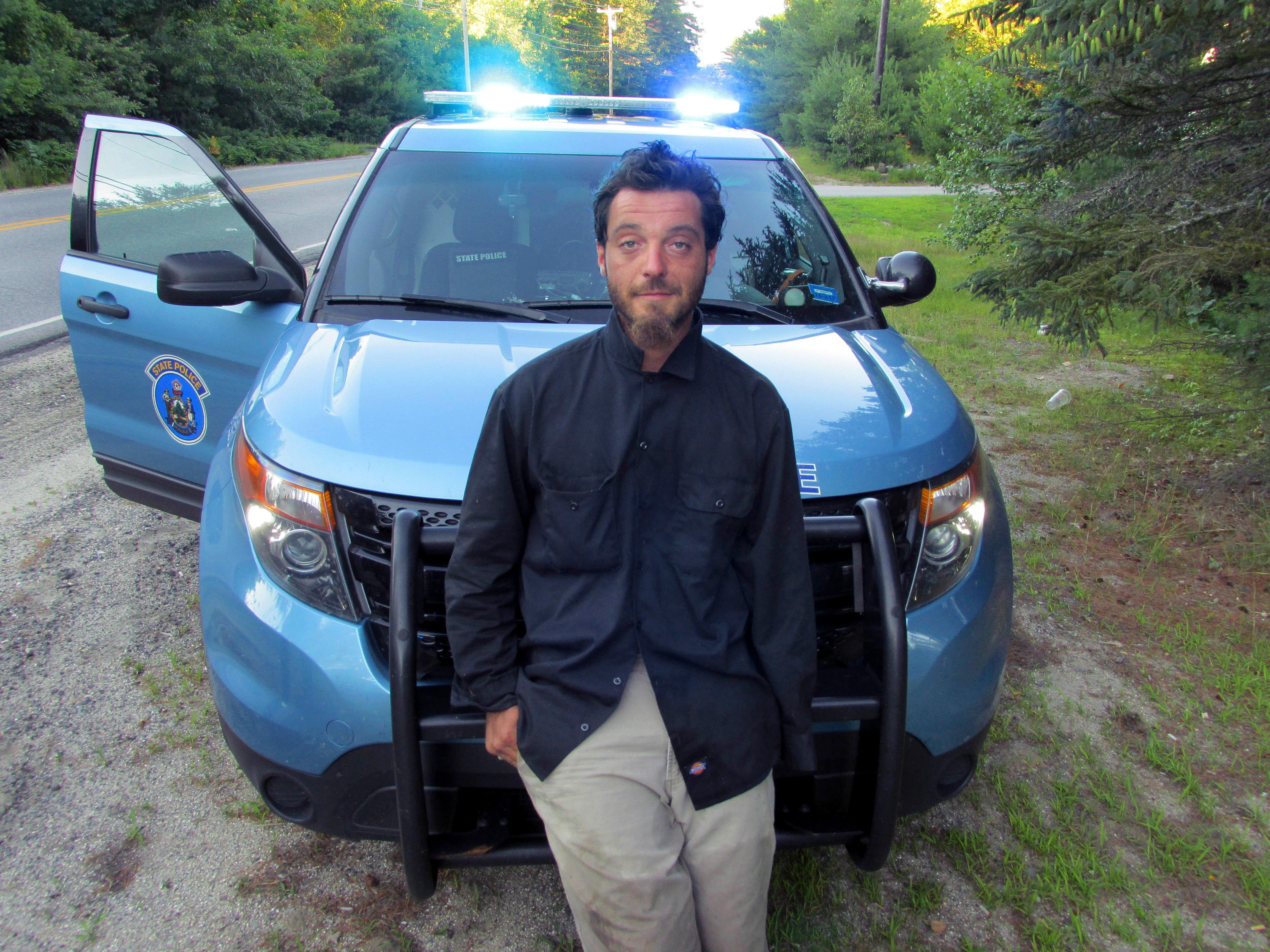 FILE - This Tuesday, July 25, 2017, file photo released by the Maine State Police shows Corey Berry, of Hollis, Maine, arrested and charged with criminal threatening after police said he was found strolling down a street wearing a clown mask with a machete taped to his amputated arm. (Maine State Police via AP, File)