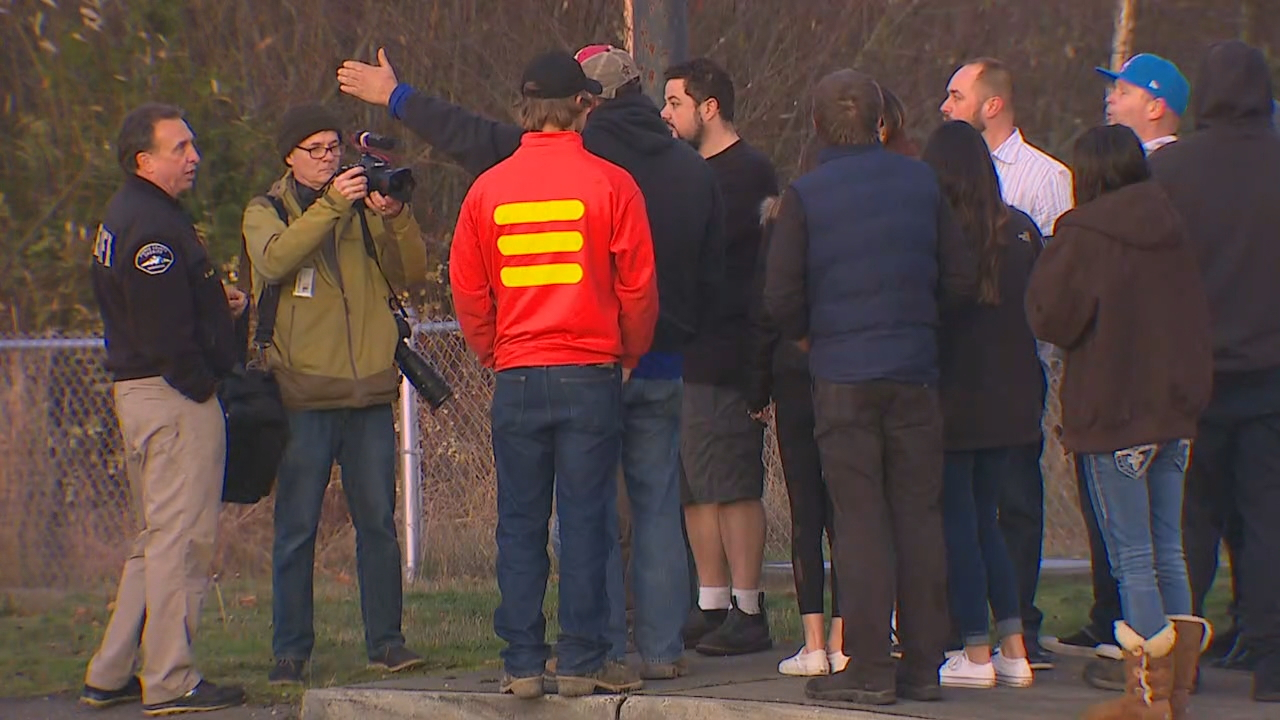 Parents wait to be reunited with their children. (Photo: KOMO News)<p></p>