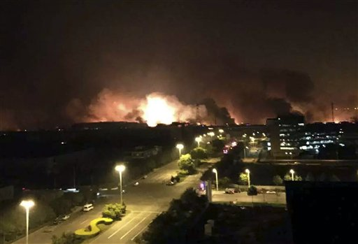 In this photo released by Xinhua News Agency smoke and fire erupt into the night sky after an explosion in the Binhai New Area in north China's Tianjin Municipality on Thursday.