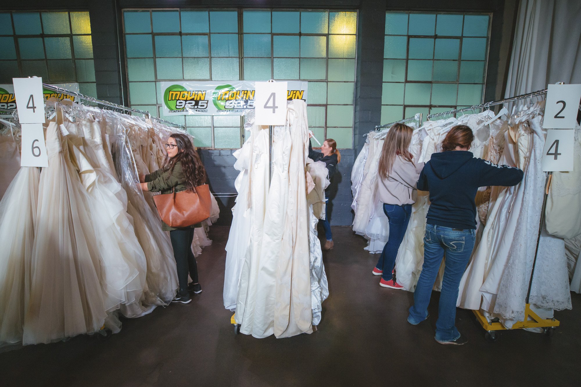 "We went from the Snopocalypse to the Bridepocalypse! Brides for a Cause hosted their sixth annual Dress Dash today Saturday, February 16 at Westlake Center. This discount wedding dress event featured more than 500 wedding dresses all priced at $150. This event is designed to ""clear the racks"" but keep in mind that Brides for a Cause has stores in Portland, Tacoma and Seattle which has all inventory including designer and new arrivals. (Images: Sunita Martini / Seattle Refined)."