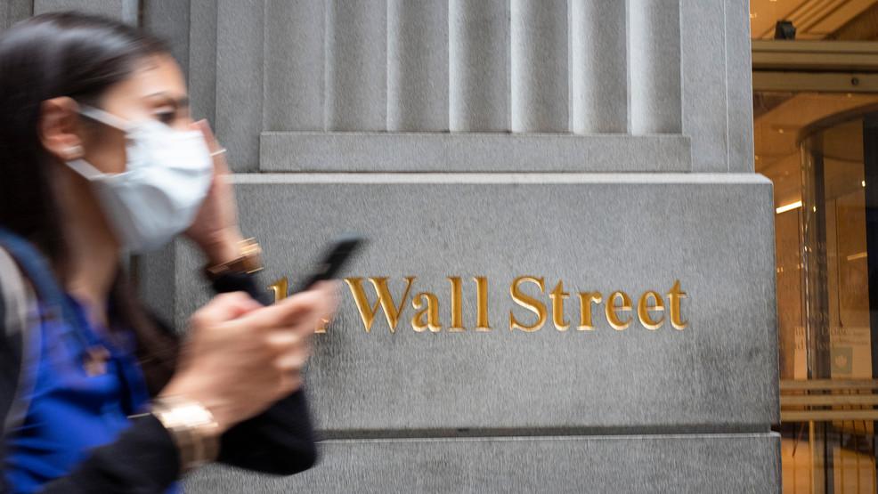 Wall Street slips as virus outbreaks dim rebound hopes