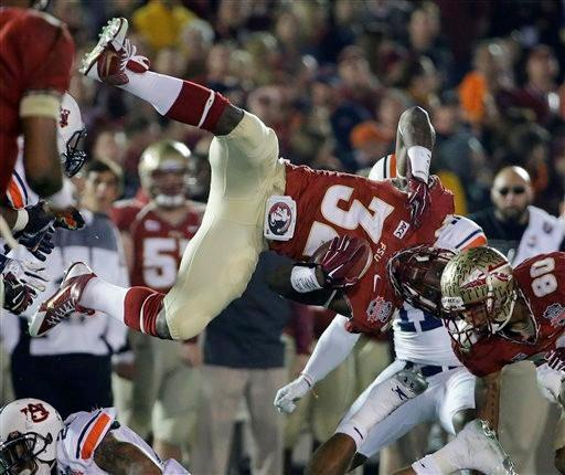 Florida State's James Wilder Jr. is upended during the second half of the NCAA BCS National Championship college football game against Auburn Monday, Jan. 6, 2014, in Pasadena, Calif.