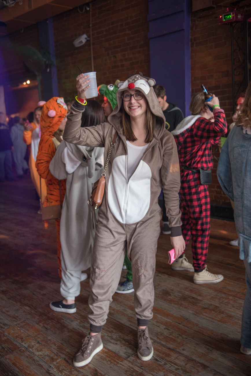 The 3rd annual Onesie Bar Crawl drank its way through Over-the-Rhine on Saturday, January 26th. Participants wore (yes, you guessed it) onesies as well as other outfits designed for maximum comfort. Everyone met up at 16-Bit Bar+Arcade on Walnut Street, then crawled their way to other area bars for event drink specials. Bars on the tour included MOTR, Mr. Pitiful's, the Hub, the Drinkery OTR, Revel, Below Zero, and OTR Live. Those who made it to the Onesie Crawl after party (at OTR Live) earned a free t-shirt for participating. / Image: Mike Menke // Published: 1.27.19