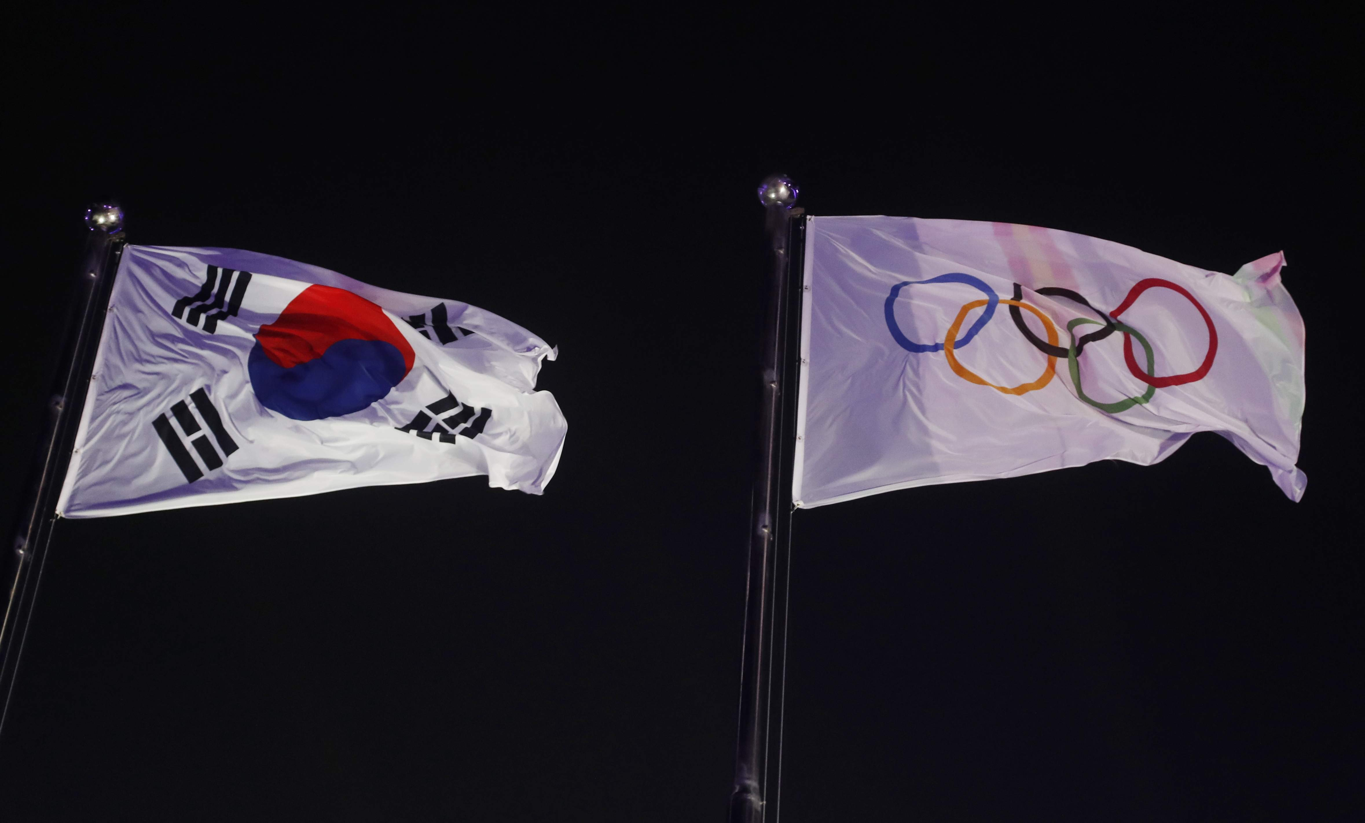 The Olympic flag hangs at right next to the South Korean flag during the opening ceremony of the 2018 Winter Olympics in Pyeongchang, South Korea, Friday, Feb. 9, 2018. (AP Photo/Petr David Josek)