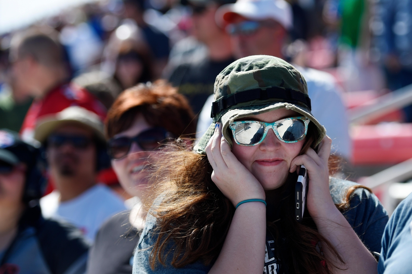 A race fan covers her ears during the Monster Energy NASCAR Cup Series Kobalt 400 Sunday, March 12, 2017, at the Las Vegas Motor Speedway. (Sam Morris/Las Vegas News Bureau)