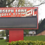 Officials: No suspects in threat left in bathroom stall at Roseburg middle school