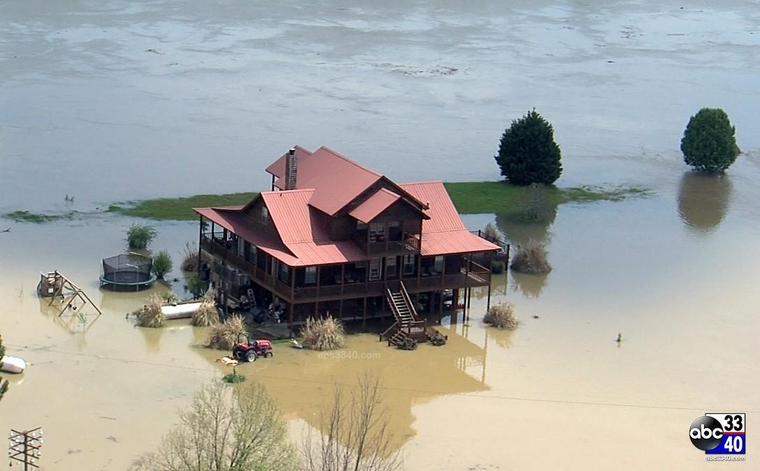 Aerial photo of a home in Moundville, Ala., Tuesday, April 8, 2014, one day after storms caused widespread flooding.