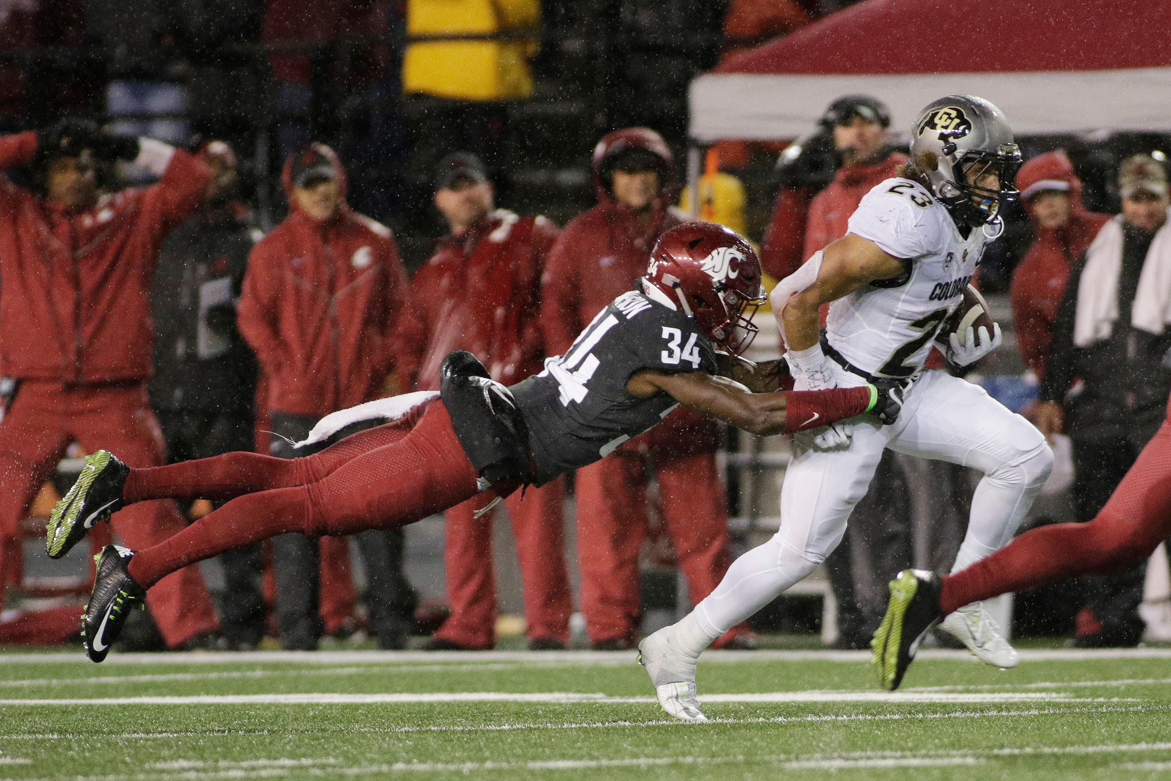 FILE - In this Oct. 21, 2017, file photo, Washington State safety Jalen Thompson (34) tackles Colorado running back Phillip Lindsay (23) during the first half of an NCAA college football game, in Pullman, Wash. Thompson was selected to the AP All-Conference Pac-12 team announced Thursday, Dec. 7, 2017. (AP Photo/Young Kwak, File)