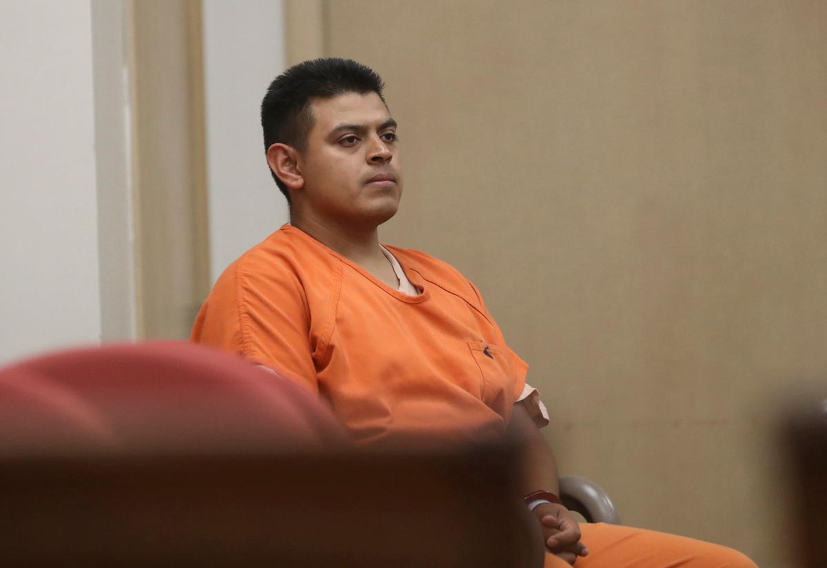 Edwin Lara, a security guard at Central Oregon Community College in Bend, Ore., waits in court in Yreka, Calif., Friday, July 29, 2016, for his arraignment. Lara's wife, Isabel Ponce-Lara, on Monday went to police in their hometown of Redmond, Ore., to report that Lara had told her he hit Kaylee Sawyer with his patrol vehicle, killing her, then panicked and hid her body, according to documents filed in court. (Greg Barnette/The Record Searchlight via AP)
