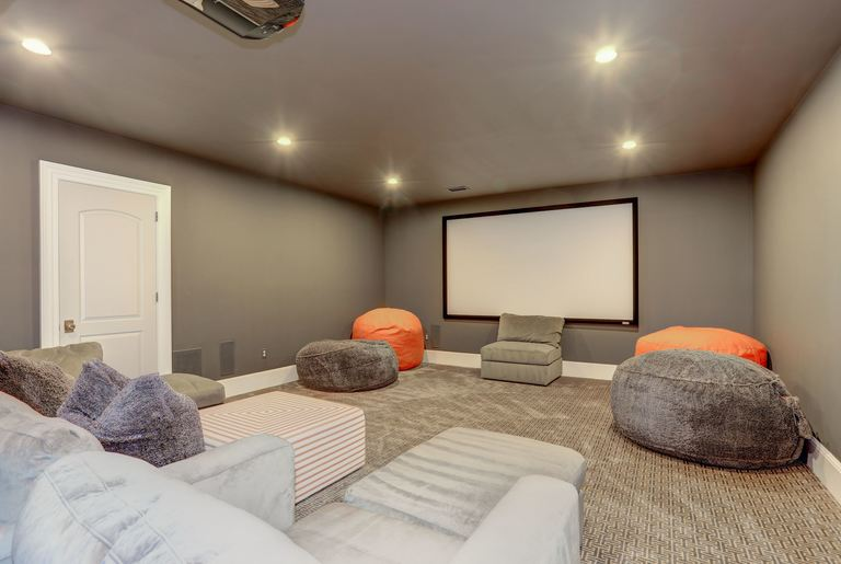 The lower level also has a rec room, game room, wet bar, theater room, exercise room, a bedroom, bathroom and powder room. (Image: Courtesy HomeVisit)<p></p>