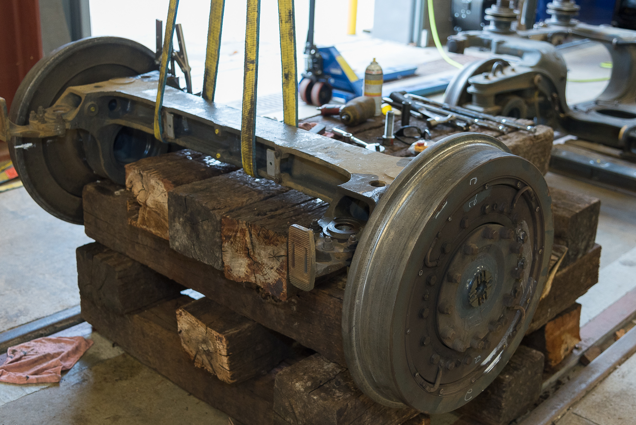 Streetcar pieces, such as this set of wheels, are on display inside the MOF garage. Streetcar maintenance is chief among the jobs of the facility. / Image: Phil Armstrong, Cincinnati Refined // Published: 11.13.17<p></p>