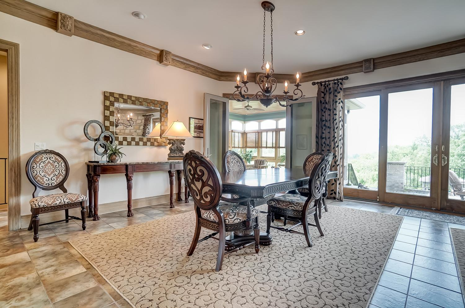 The hearth room opens to the great room's breakfast and additional dining area. The floor-to-ceiling glass sliders open to a gorgeous terrace overlooking the beautifully manicured three acres and rolling hills. / Image: Wow Video Tours // Published: 6.8.18