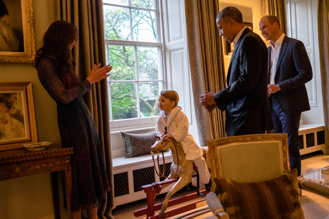 In this hand out photo released by Kensington Palace, Britain's Prince George, centre, talks to Kate, the Duchess of Cambridge after meeting US  President Barack Obama, second right, and first lady Michelle Obama, at Kensington Palace, London, Friday April 22, 2016. Prince William is at right.  (Pete Souza/Kensington Palace via AP)