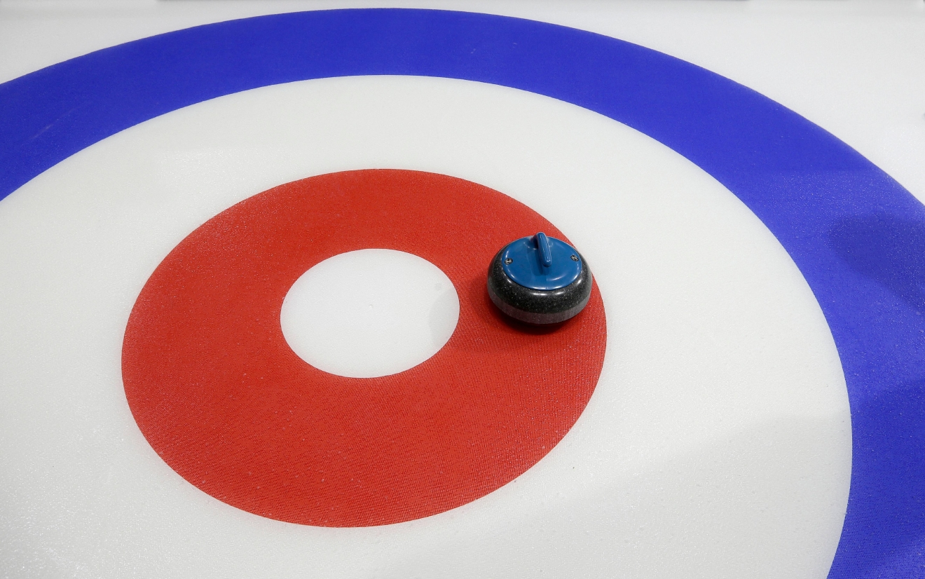 In this Wednesday, March 1, 2017 photo, a curling stone sits on the ice during a media demonstration the day before the opening ceremonies of the USA Curling Nationals in Everett, Wash. Associated Press sportswriter Tim Booth tried his hand at the sport and found it challenging both to get the rock down the ice and keeping his footing. (AP Photo/Ted S. Warren)