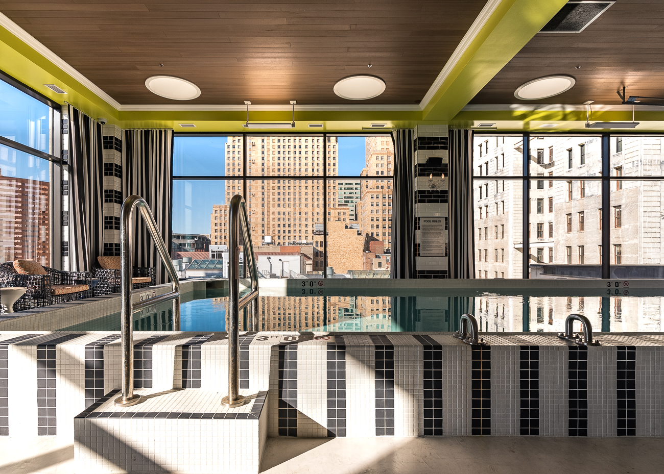 The pool sits high above street level and is temperature controlled for year-round use. A spa sits directly beside the pool. On warm days, a door can be opened and residents are able to sit outside on the deck to sunbathe. Further down the path on the deck, residents will find a convenient outdoor area for their dogs. / Image: Phil Armstrong, Cincinnati Refined // Published: 11.13.18