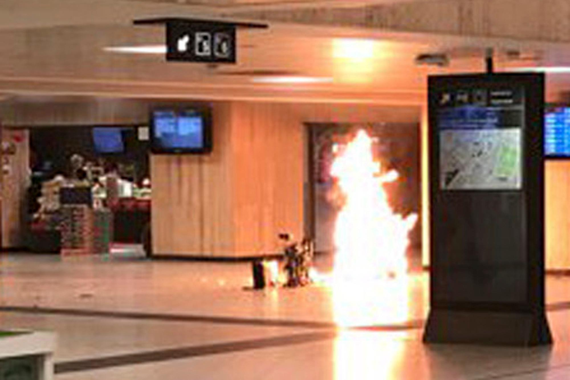 "In this June 20, 2017 photo a man blows up an explosive device in the station in Brussels. The man was shot by soldiers afterwards in what prosecutors are treating as a ""terrorist attack."" He lay still for several hours while a bomb squad checked whether he was carrying more explosives and later died. No one else was hurt. (Remy Bonnaffe via AP)  MANDATORY CREDIT"