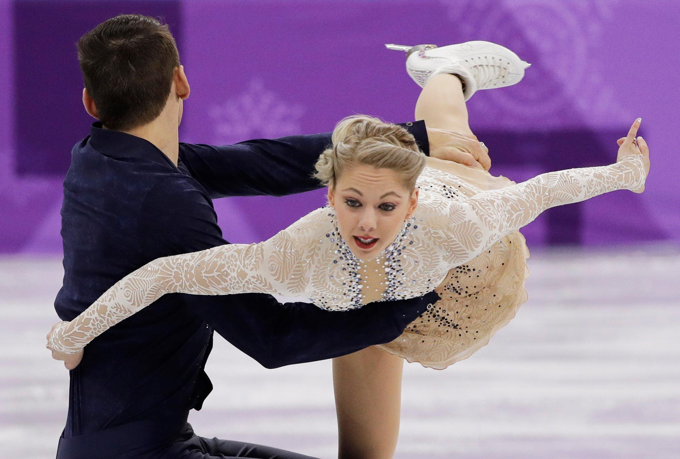 Alexa Scimeca Knierim and Chris Knierim of the USA perform in the pair skating short program team event at the 2018 Winter Olympics in Gangneung, South Korea, Friday, Feb. 9, 2018. (AP Photo/David J. Phillip)
