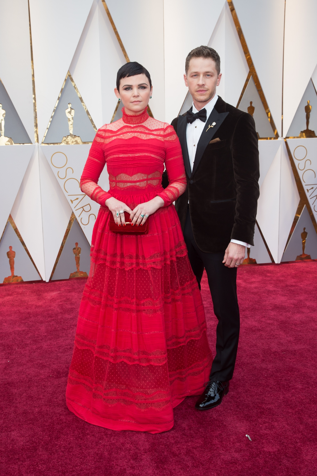 #35: Ginnifer Goodwin. What is up with high lace collars this year? Am I missing something? Red is a wonderful color on Gin, but we think if this had been a strapless dress it would have been tre suaver. (Image: AMPAS)