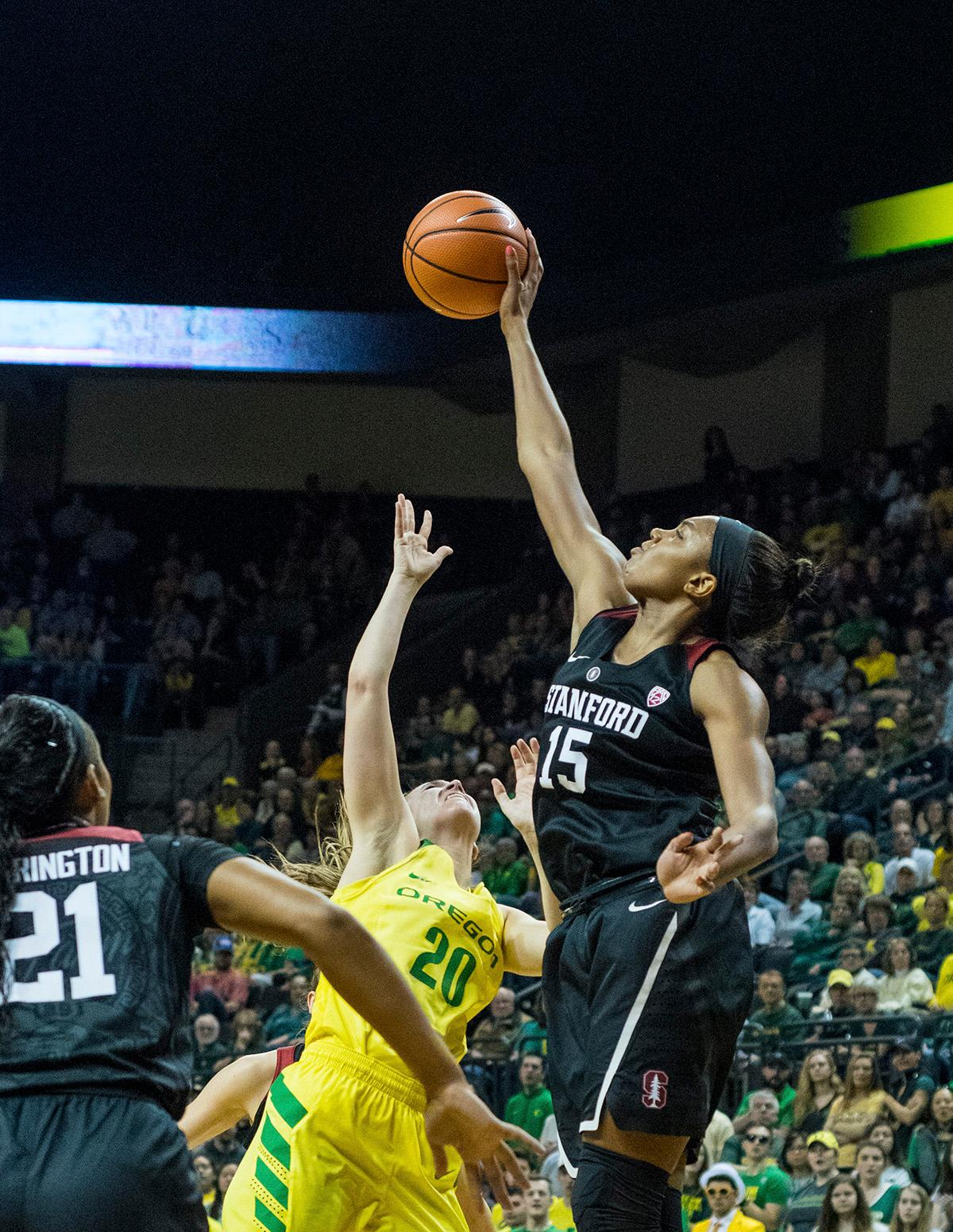 Stanford Cardinal Maya Dodson (#15) blocks the shot of Oregon Ducks Sabrina Ionescu (#20). The Stanford Cardinal defeated the Oregon Ducks 78-65 on Sunday afternoon at Matthew Knight Arena. Stanford is now 10-2 in conference play and with this loss the Ducks drop to 10-2. Leading the Stanford Cardinal was Brittany McPhee with 33 points, Alanna Smith with 14 points, and Kiana Williams with 14 points. For the Ducks Sabrina Ionescu led with 22 points, Ruthy Hebard added 16 points, and Satou Sabally put in 14 points. Photo by Rhianna Gelhart, Oregon News Lab