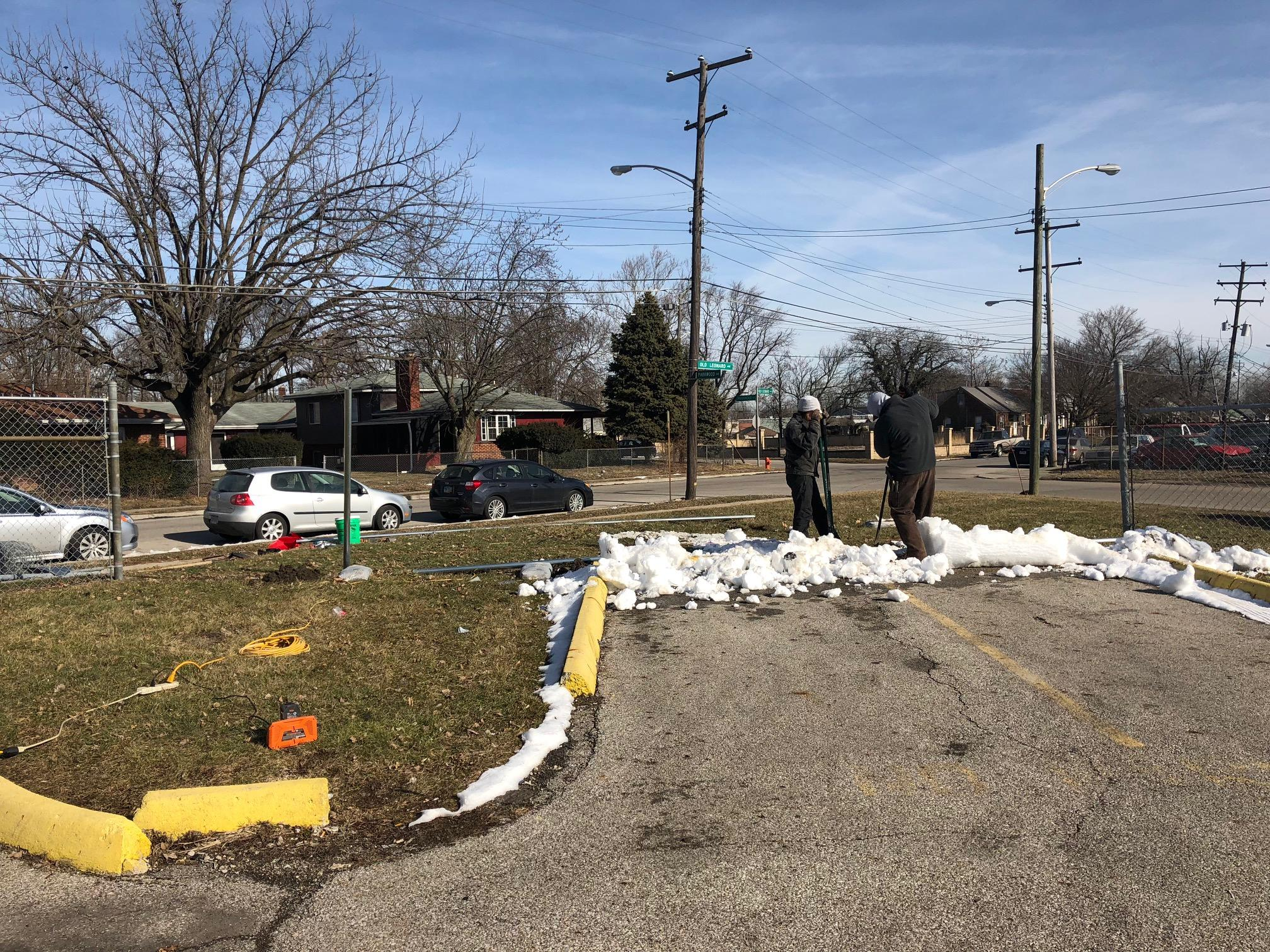 <p>People fixing the fence Tuesday morning where truck was driven through. (WSYX/WTTE)</p>
