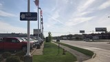 Dealership says truck driver declined to use car lot drop-off area