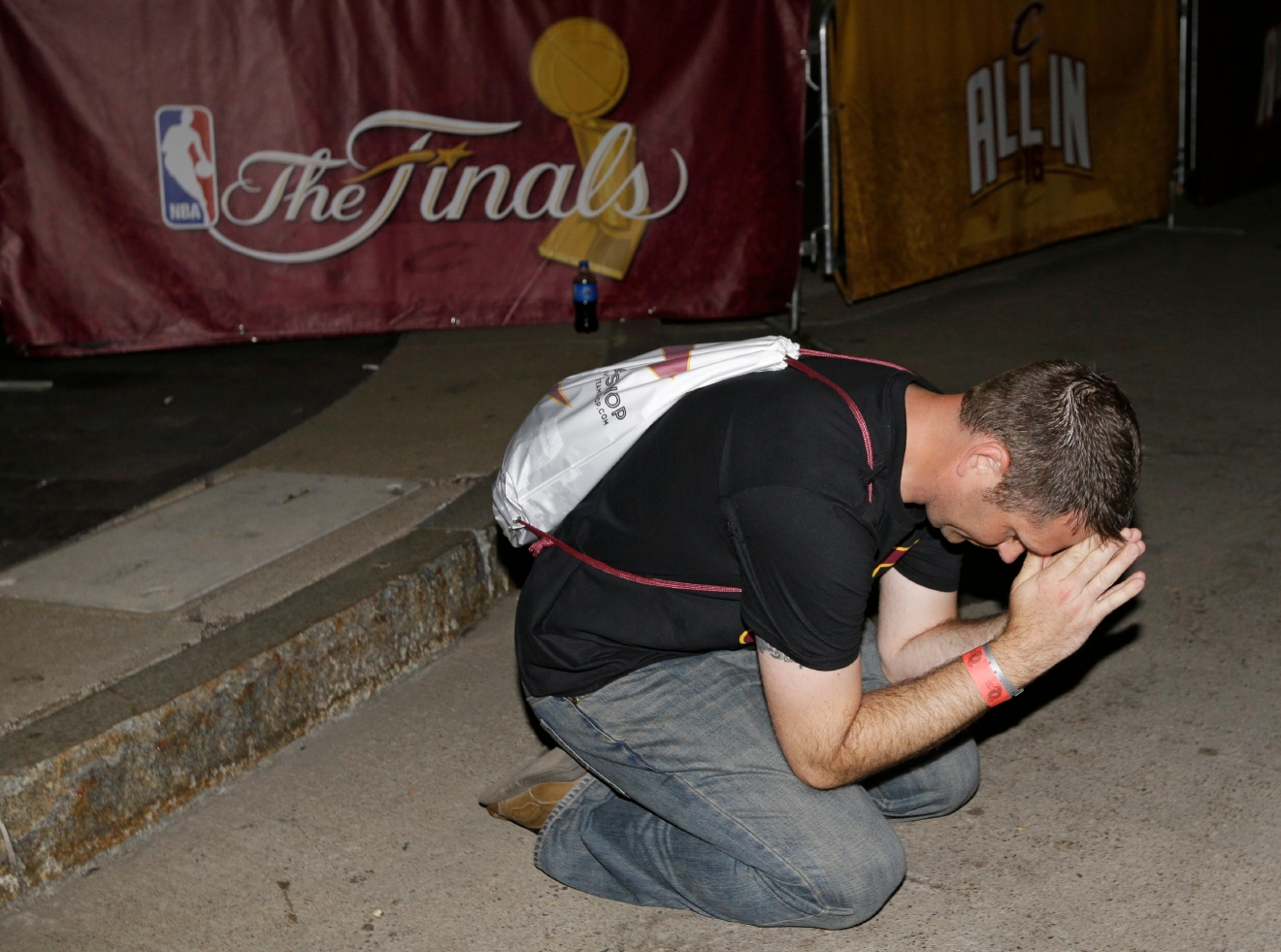 Brian Wilson prays in the final minutes of Game 7 of the NBA basketball Finals between the Cleveland Cavaliers and the Golden State Warriors, Sunday, June 19, 2016, in Cleveland. The Cavaliers won 93-89. (AP Photo/Tony Dejak)