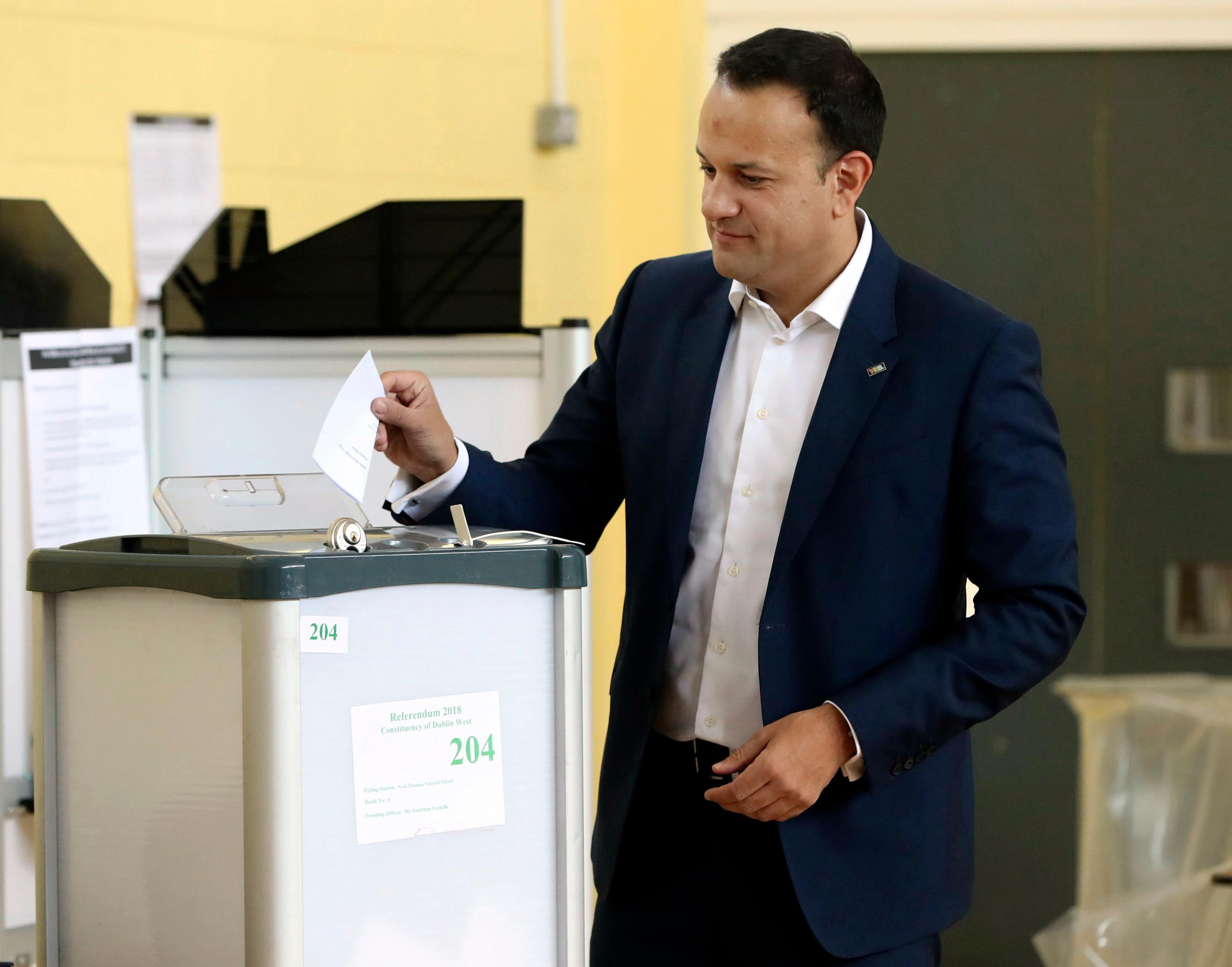 Ireland's Prime Minister Leo Varadkar cast his vote at the polling station as the country goes to the polls to vote in the referendum on the 8th Amendment of the Irish Constitution, in Dublin, Friday, May 25, 2018. Voters throughout Ireland have begun casting votes in a referendum that may lead to a loosening of the country's strict ban on most abortions. (Niall Carson/PA via AP)