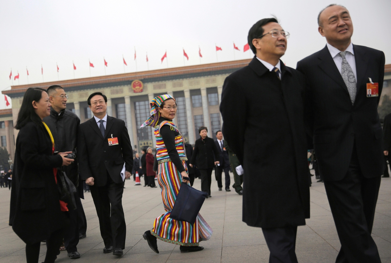 FILE - In this March 12, 2015 file photo, delegates leave the Great Hall of the People after attending a plenary session of the National People's Congress in Beijing. Democracy Chinese-style will go on display when the country's rubberstamp legislature, the National People's Congress opens its annual sessions in Beijing on Sunday, March 5, 2017. (AP Photo/Andy Wong, File)