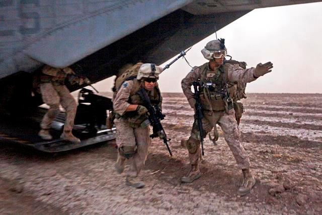 U.S. Marines exit a CH-53E Super Stallion helicopter during an operation in Tangi Sufla in Helmand province, Afghanistan, July 18, 2013.