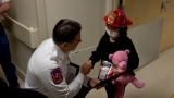 Children going through cancer treatment become honorary firefighters