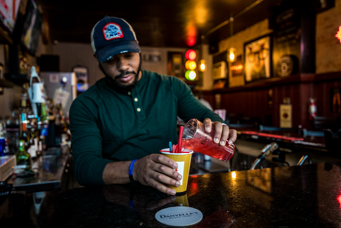 Keith Gwynn, co-owner of Danyelle's Bellevue Tavern, making our cocktail BED ready / Image: Catherine Viox{ }// Published: 12.9.19