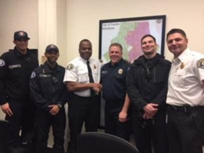 Seattle Fire Chief Harold Scoggins and Assistant Chief Bryan Hastings recognized Quinlan for his life-saving actions after the crash on I-5, Feb. 6, 2018. (Photo: Seattle Fire)