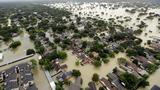 The Latest: Harvey floods shelter for evacuees in Texas