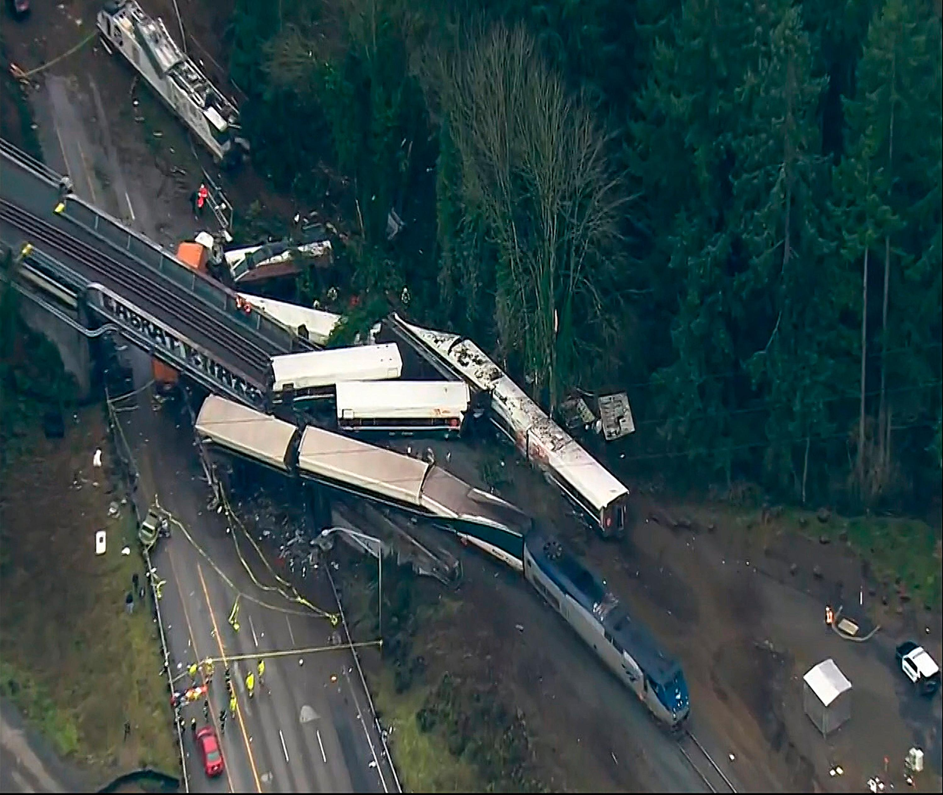 "This aerial image from video provided by KOMO-TV, shows the site of an Amtrak train that derailed south of Seattle on Monday, Dec. 18, 2017. Authorities reported ""injuries and casualties."" The train derailed about 40 miles (64 kilometers) south of Seattle before 8 a.m., spilling at least one train car on to busy Interstate 5. (KOMO-TV via AP) TV OUT MANDATORY CREDIT"