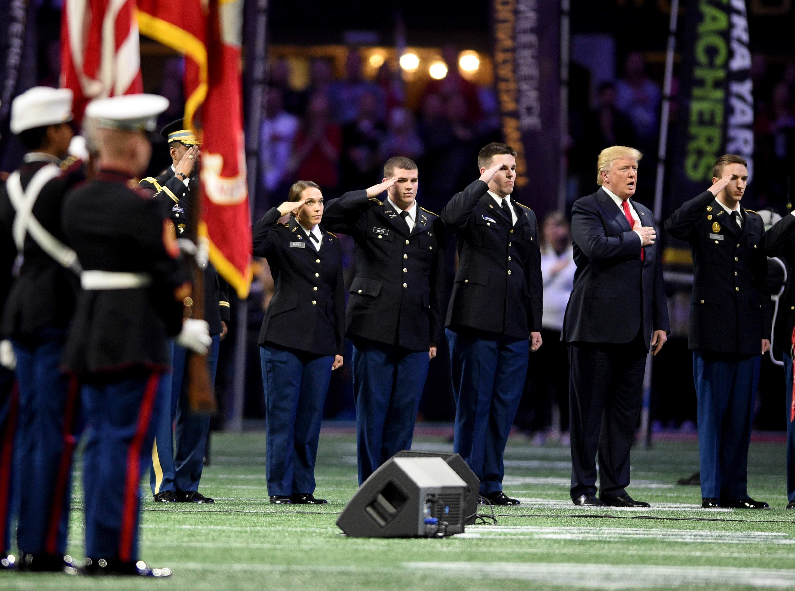 President Trump took the field for the Natioal Anthem during the 2018 College Football Playoff National Championship at Mercedes-Benz Stadium in Atlanta, Ga., Monday evening January 8, 2018. MICHAEL HOLAHAN/AUGUSTA CHRONICLE
