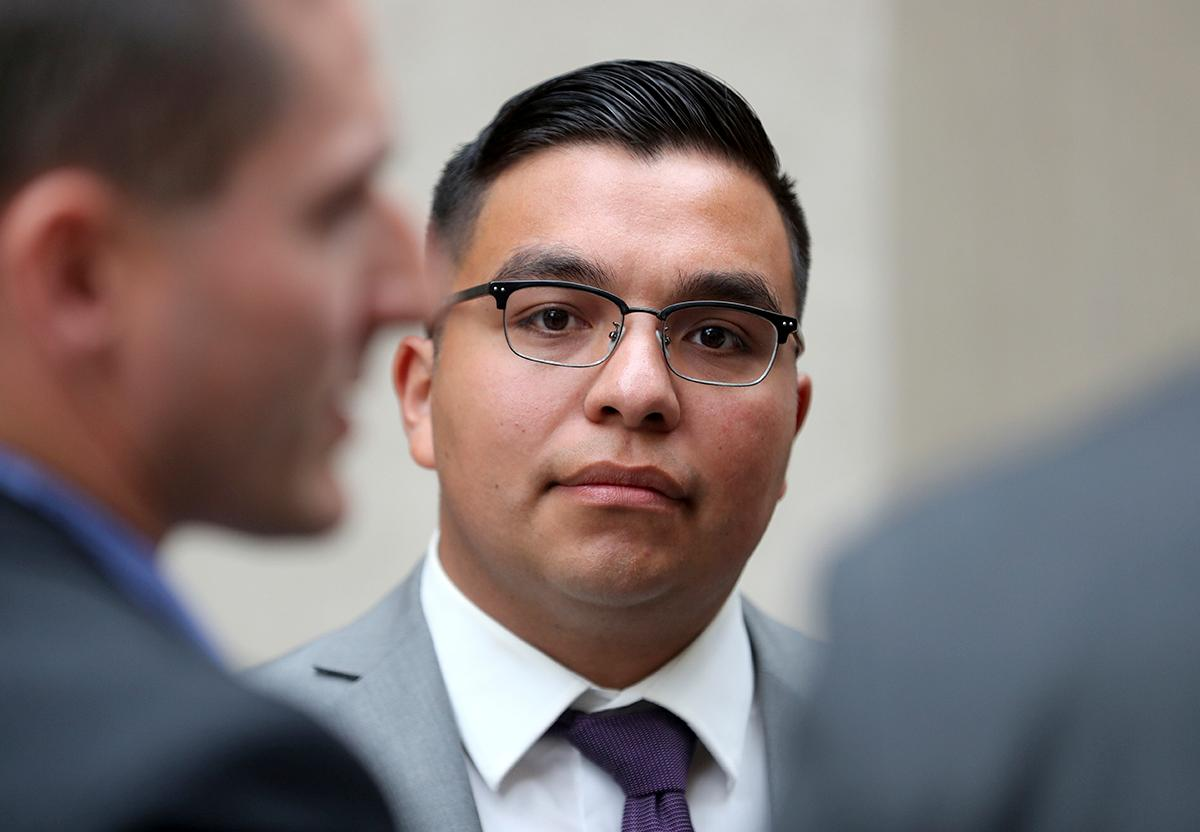 FILE - In this May 30, 2017, file photo, St. Anthony police officer Jeronimo Yanez stands outside the Ramsey County Courthouse while waiting for a ride in St. Paul, Minn. Closing arguments are set for Monday, June 12, in a Minnesota police officer's manslaughter trial in the death of a black motorist. (David Joles/Star Tribune via AP, File)