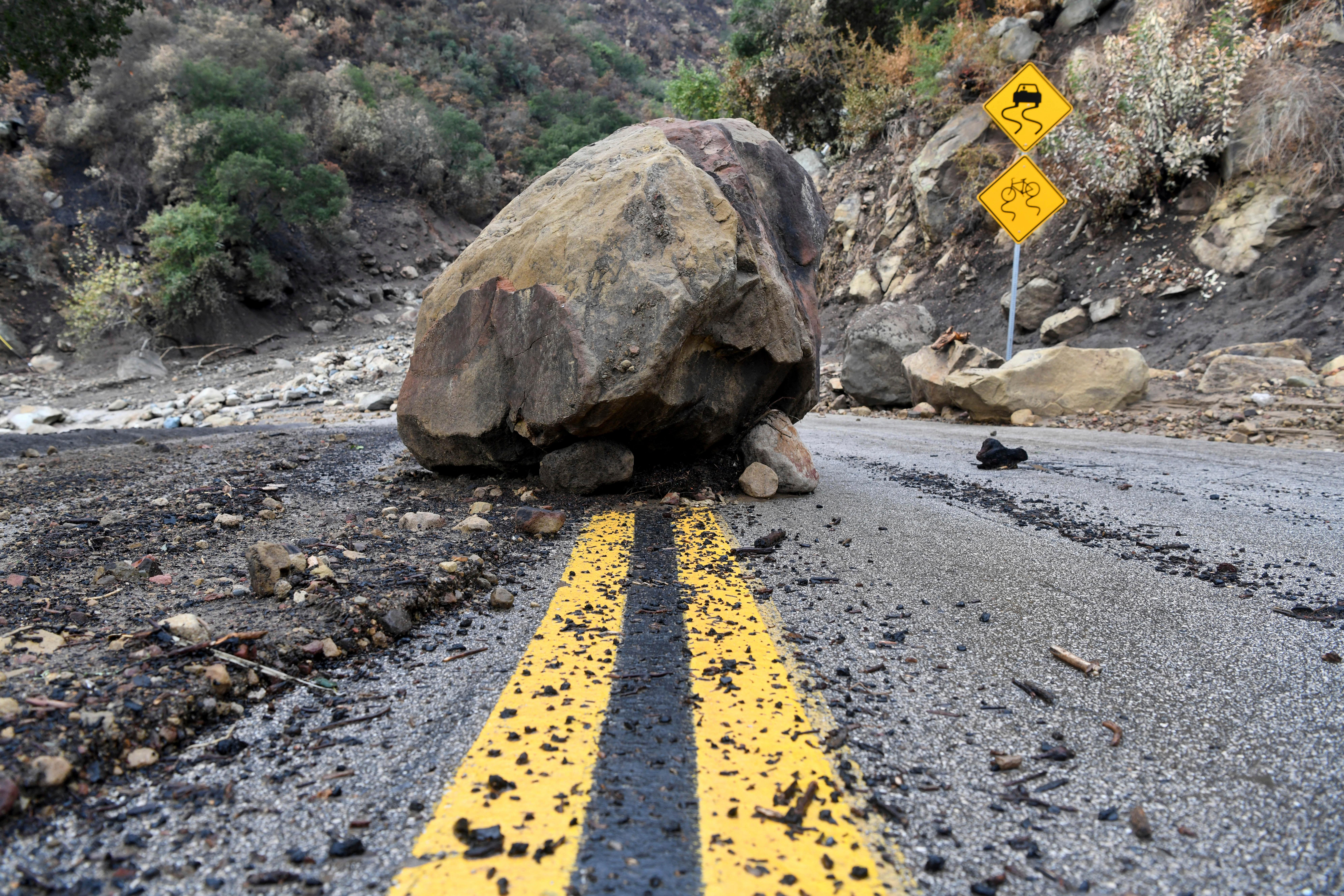 A large boulder sits in the middle of Bella Vista Drive in Montecito, Calif., following the rain storm, Tuesday, Jan. 9, 2018. (AP Photo/Michael Owen Baker)