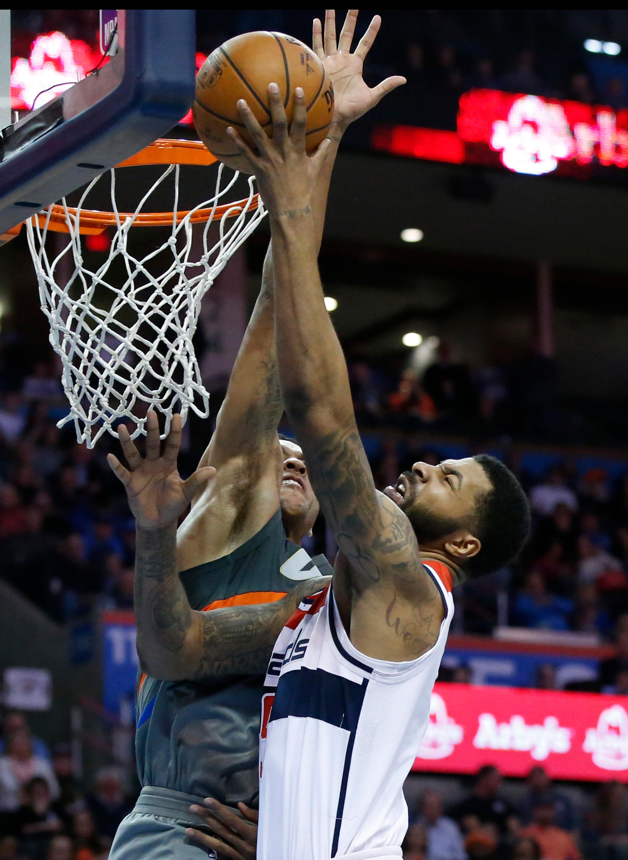 Washington Wizards forward Markieff Morris shoots during the second quarter of the team's NBA basketball game against the Oklahoma City Thunder in Oklahoma City, Thursday, Jan. 25, 2018. (AP Photo/Sue Ogrocki)
