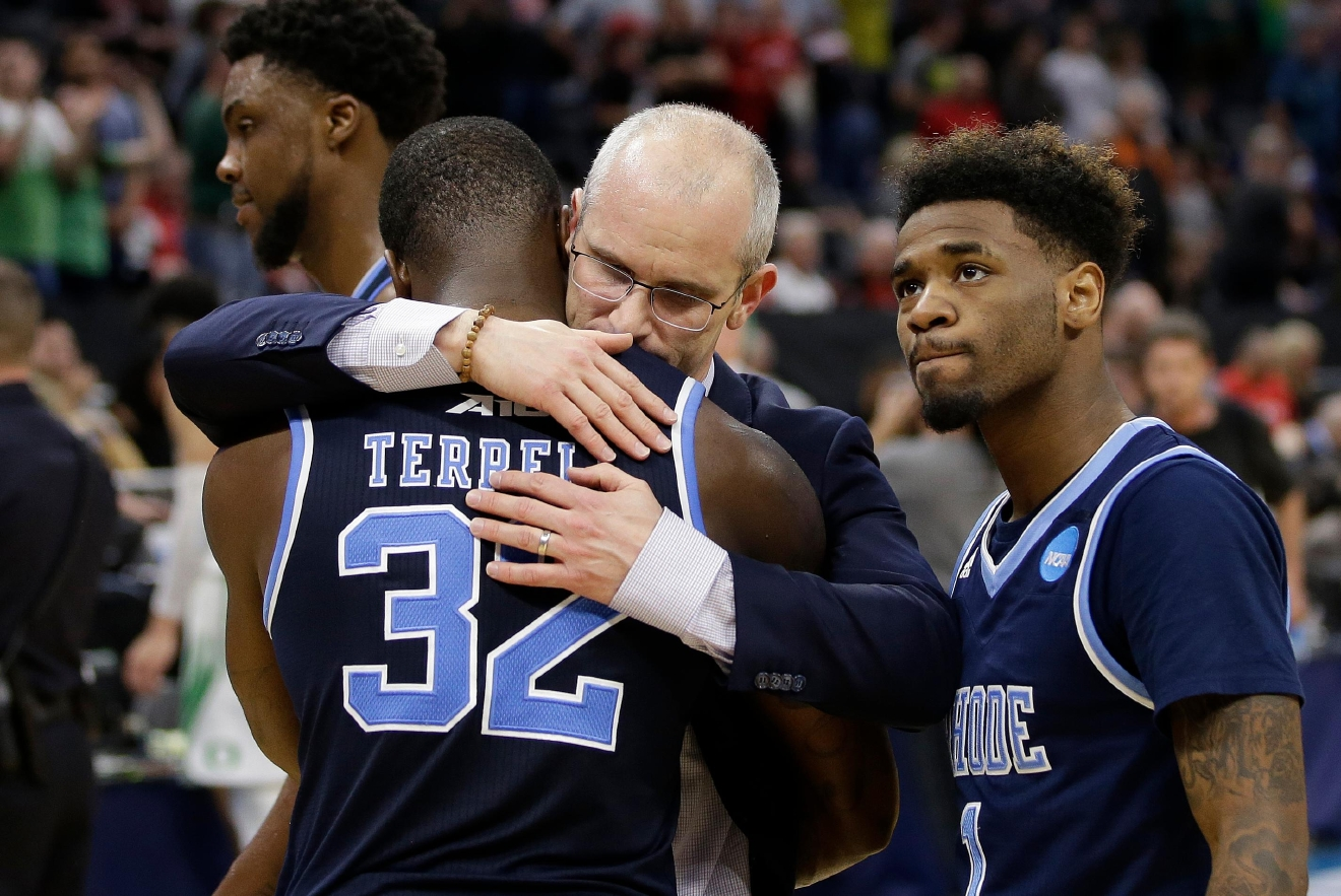 Rhode Island coach Dan Hurley hugs guard Jared Terrell after the team's 75-72 loss to Oregon in a second-round game of the NCAA men's college basketball tournament in Sacramento, Calif., Sunday, March 19, 2017. (AP Photo/Rich Pedroncelli)