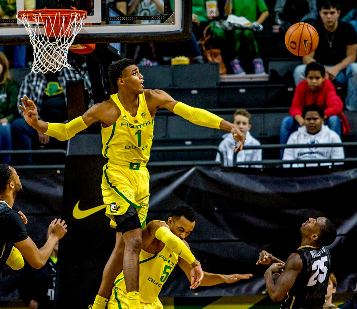The Duck's Kenny Wooten (#1) blocks a shot. The Oregon Ducks defeated the Colorado Buffaloes 77-62 at Matthew Knight Arena on Sunday. Troy Brown had a season-high score of 21 points, Elijah Brown added 17, while Kenny Wooten and Payton Pritchard added 13 and 12 respectively. Oregon is now 1-1 in conference play. The Ducks next face off against the Oregon State Beavers in Corvallis on Friday, January 5th. Photo by August Frank, Oregon News Lab