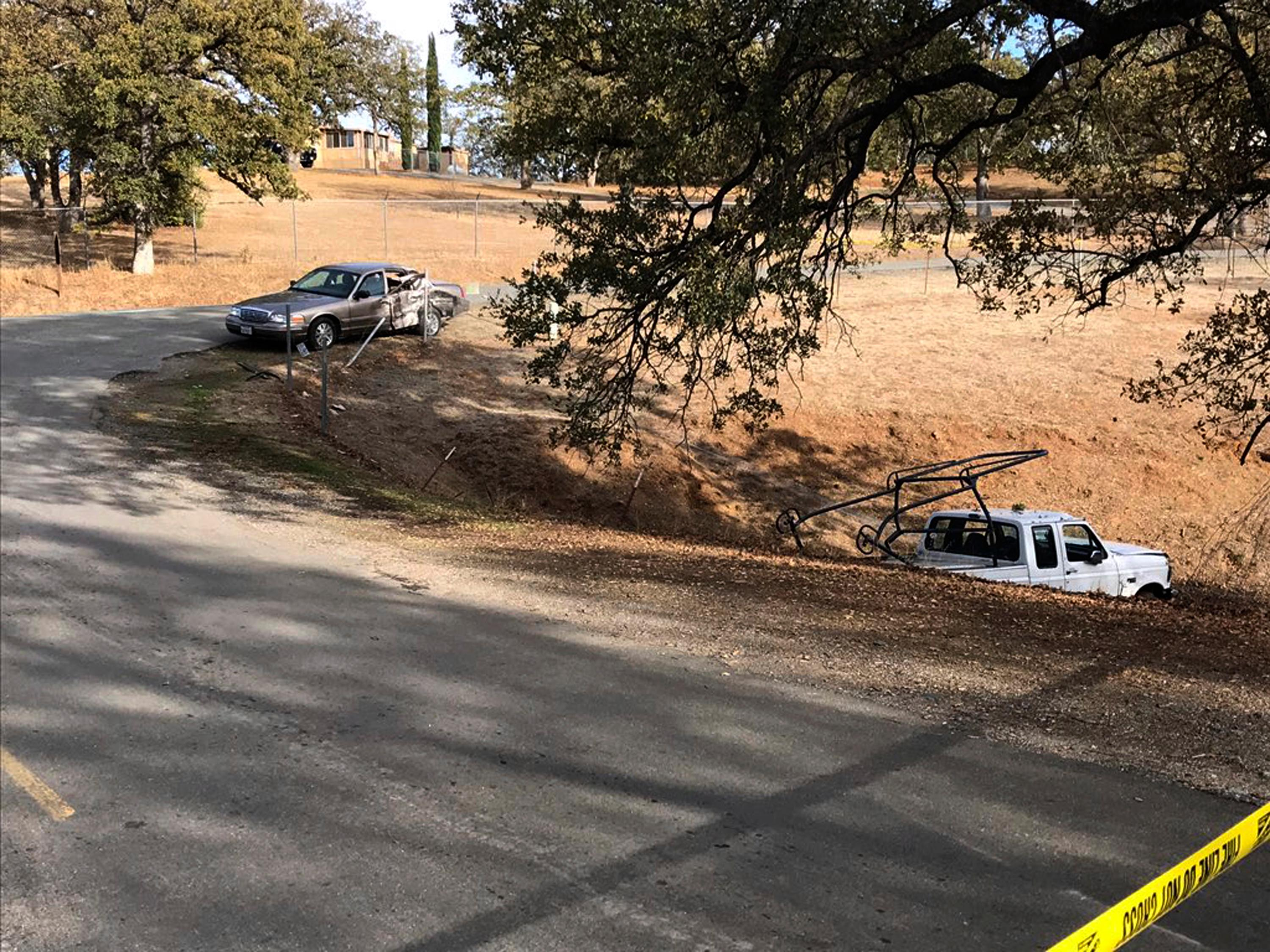 This is one of seven crime scenes in the mass shooting in Rancho Tehama near Red Bluff, California, on Tuesday, Nov. 14, 2017. Tehama County Assistant Sheriff Phil Johnston says investigators are trying to determine a motive in the shootings Tuesday in the small community of Tehama Ranch Reserve.  (Jim Schultz/The Record Searchlight via AP)