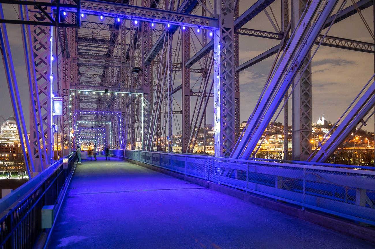 If you want something safe to do this season, check out the Purple People Bridge between November 20, 2020 and January 15, 2021 to see it lit up for the holidays. Every night the bridge is illuminated with festive, photogenic lighting. A thousand purple and white bulbs have been strung on the bridge from end to end while moving projection lights scatter across the decking. As you walk from Cincinnati to Newport (or the opposite way), you'll hear Christmas music on the speaker system overhead. The decorating is part of Winter Nights, River Lights—Newport's initiative to dress up the Levee and bridge for the holidays while supporting The Wish Tree Program. / Image: Phil Armstrong // Published: 12.1.20