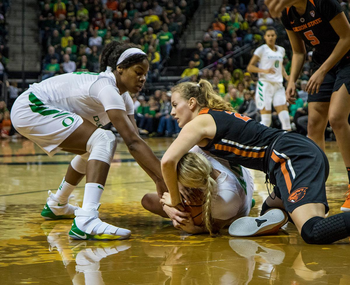 Oregon Ducks Ruthy Hebard (#24) and Mallory McGwire (#44) fight for the ball on the floor. The Oregon Ducks defeated the Oregon State Beavers 75-63 on Sunday afternoon in front of a crowd of 7,249 at Matthew Knight Arena. The Ducks and Beavers split the two game Civil War with the Beavers defeating the Ducks on Friday night in Corvallis. The Ducks had four players in double digits: Satou Sabally with 21 points, Maite Cazorla with 16, Sabrina Ionescu with 15, and Mallory McGwire with 14. The Ducks shot 48.4% from the floor compared to the Beavers 37.3%. The Ducks are now 7-1 in conference play. Photo by Rhianna Gelhart, Oregon News Lab