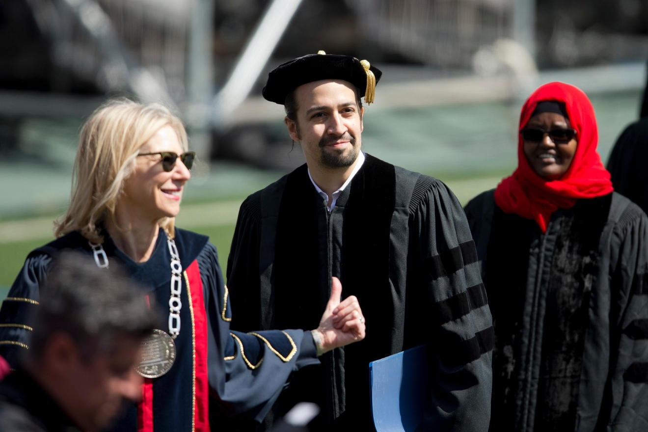 "Lin-Manuel Miranda, center, creator of the Broadway musical ""Hamilton,"" follows University of Pennsylvania President Amy Gutmann during the university's commencement ceremony, Monday, May 16, 2016, in Philadelphia. Miranda will speak at the ceremony and receive an honorary degree.   (AP Photo/Matt Rourke)"