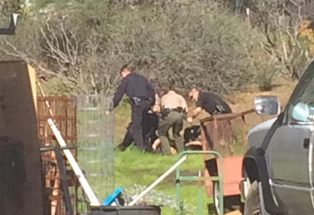 Police confront the unidentified suspect (Courtesy: Crystal Sainz)<p></p>