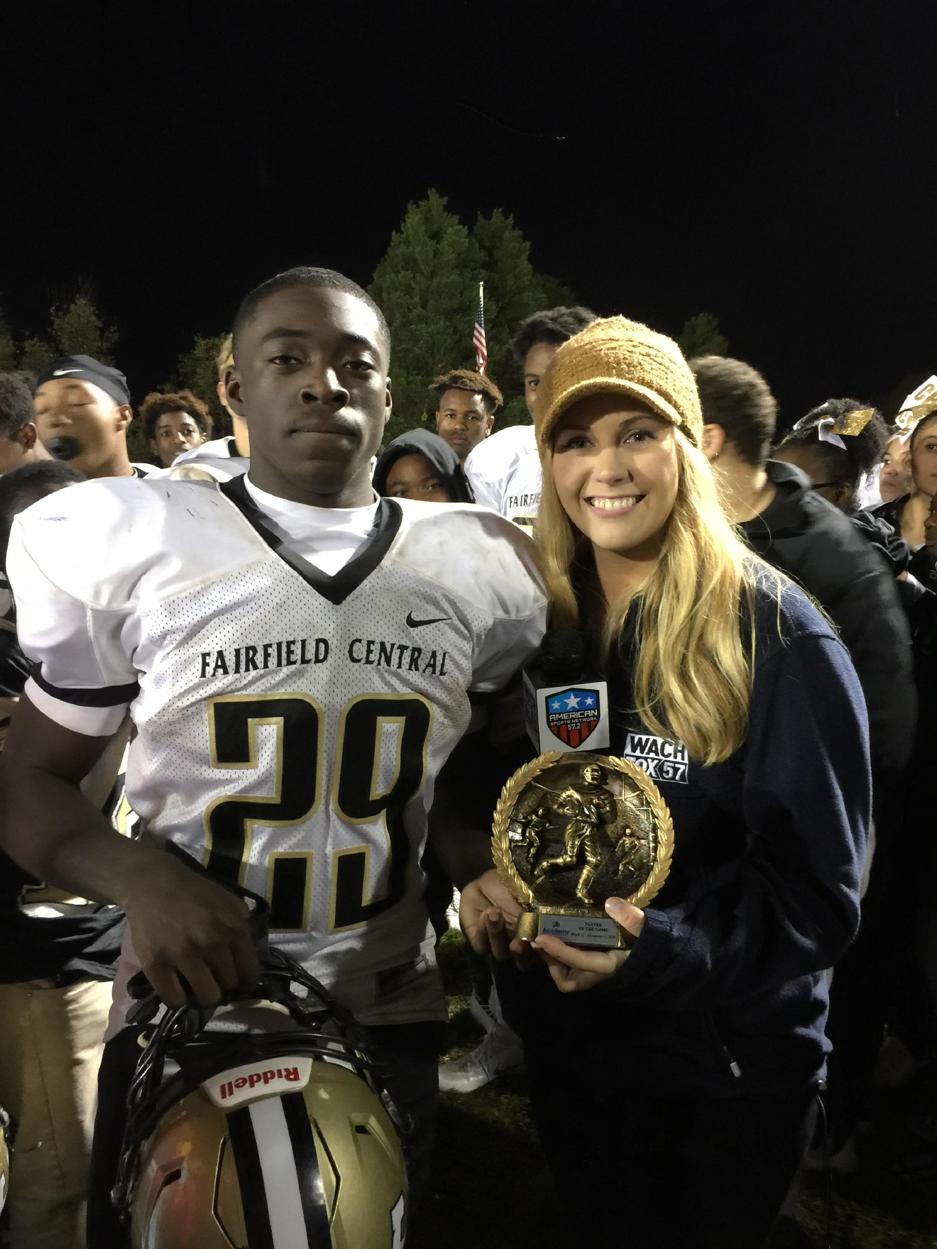 Courtney King presents Fairfield Central's Tony Ruff with the Player of the Game award.